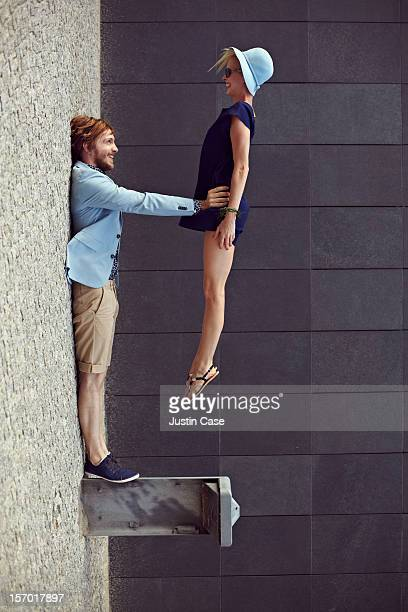 Man holding woman by the hips