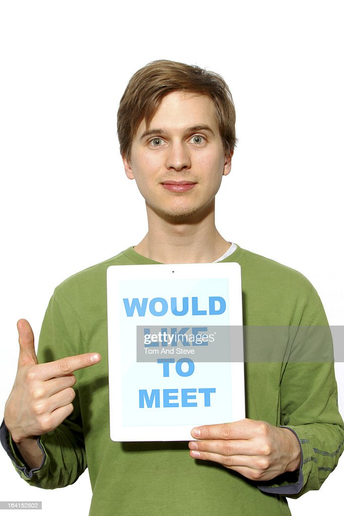 Man holding 'would like to meet' sign on tablet