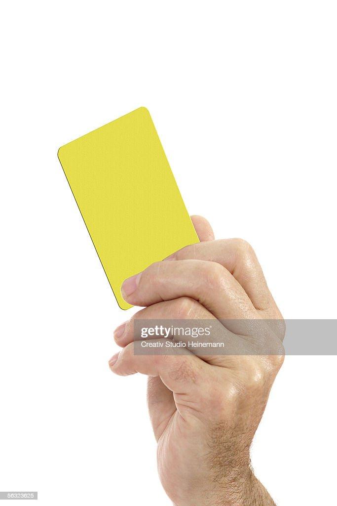 Man holding yellow card