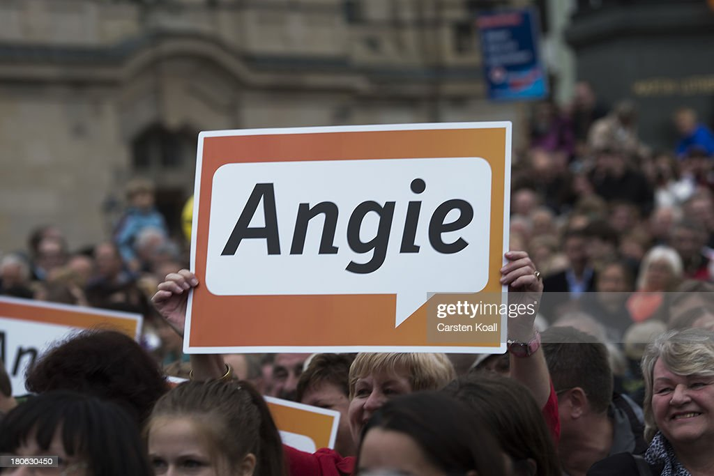A man holds a banner with the written letters 'Angie', a nickname of German Chancellor and Chairwoman of the German Christian Democrats (CDU) Angela Merkel during CDU election campaign rally on September 15, 2013 in Dresden, Germany. Merkel has a strong lead over her political rivals and the CDU is expected to win federal elections scheduled for September 22