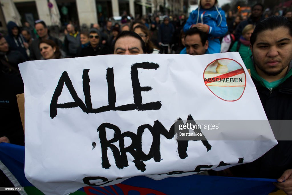 A man holds a banner with the written slogan 'Alle Roma Bleiben' (All Roma Stay) as ethnic Roma protest against discrimination against Roma on International Roma Day on April 8, 2013 in Berlin, Germany. Western Europe has experienced a large influx of Roma, who are also called Gypsies, from Romania and Bulgaria in recent years following the accession of the two countries to the European Union. Restrictions on the rights of Romanian and Bulgarian citizens to work in the EU are scheduled to end at the end of 2013.