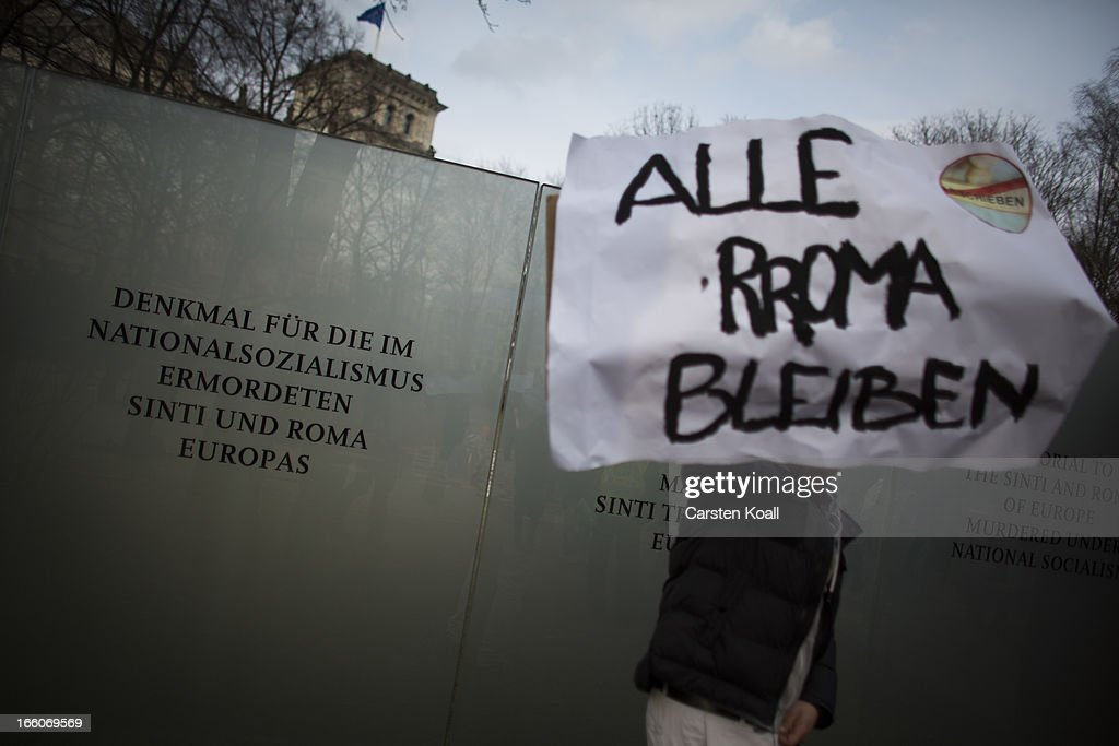 A man holds a banner with the written slogan 'Alle Roma Bleiben' (All Roma Stay) as ethnic Roma protest in front of the Memorial for under Nazism murdered Sinti and Roma of Europe, against discrimination against Roma on International Roma Day on April 8, 2013 in Berlin, Germany. Western Europe has experienced a large influx of Roma, who are also called Gypsies, from Romania and Bulgaria in recent years following the accession of the two countries to the European Union. Restrictions on the rights of Romanian and Bulgarian citizens to work in the EU are scheduled to end at the end of 2013.