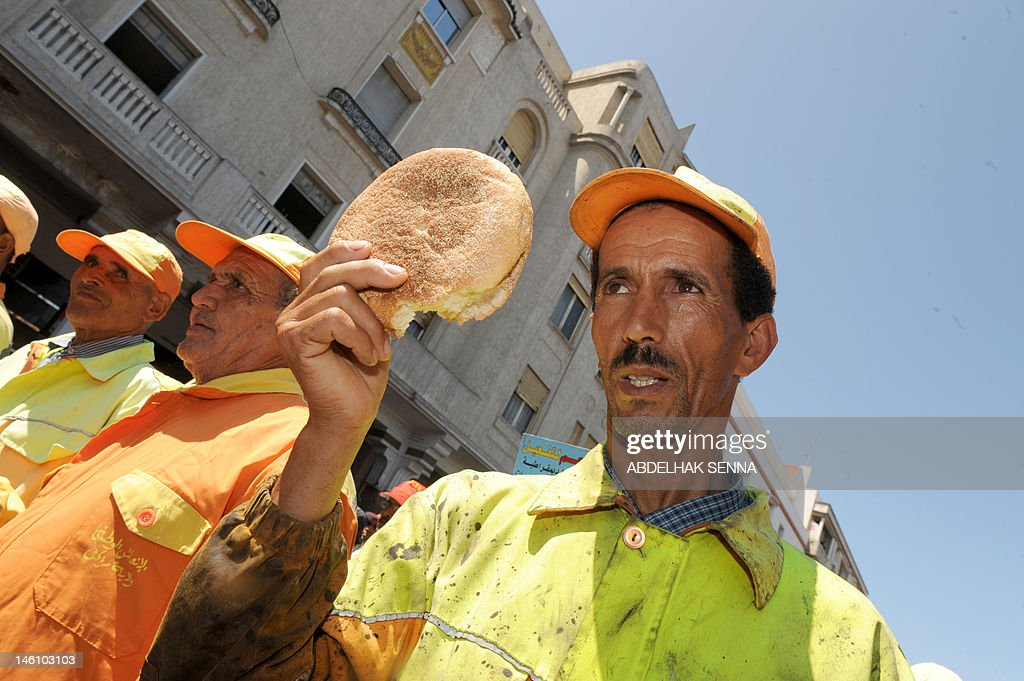 A man holds a bread loaf during a demonstration organized by trade unions to protest against Islamist-led Moroccan government and to denounce the cost of living in Rabat on June 10, 2012.