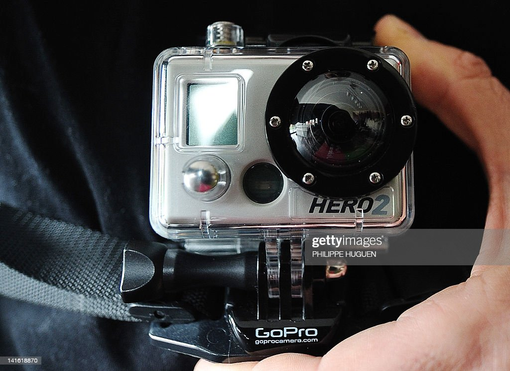 A man holds a camera GoPro on March 20, 2012, in the northern French city of Lille. The man who went on a shooting spree in a French Jewish school may have recorded his crime as he was wearing a sports video camera strapped to his chest, French Interior Minister Claude Gueant said today. AFP PHOTO / PHILIPPE HUGUEN