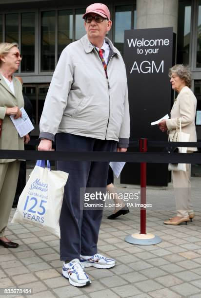 A man holds a carrier bag celebrating 125 year anniversary of Marks and Spencer as shareholders queue to get in to the MS Annual General Meeting at...