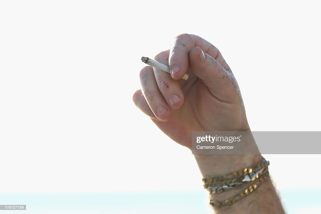 A man holds a cigarette on August 1, 2013 in Sydney, Australia. In a plan announced today, the government will increase the excise on tobacco by 12.5 per cent annually over the next four years, raising over AUD$5 billion. The hike is estimated to increase the cost of cigarettes by AUD$5 by 2016, and is the first increase in the tobacco excise since 2010.