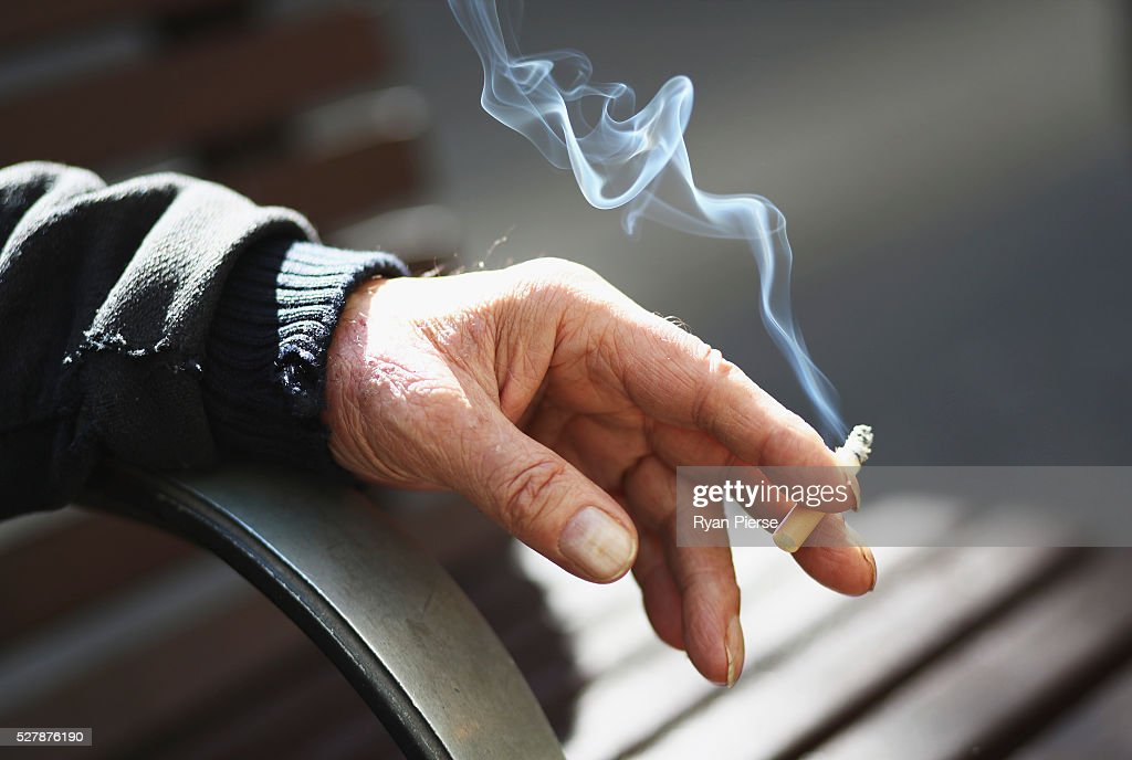 A man holds a cigarette on May 04, 2016 in Sydney, New South Wales. The Australian Government yesterday announced in their budget four annual 12.5 per cent increases to tobacco excise and excise equivalent customs duties which will significantly push up the over-the counter price up to AUD$40 by 2020.