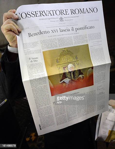 A man holds a copy of the Vatican's newspaper the Osservatore Romano with the frontpage dedicated to the resignation of Pope Benedict XVI on February...