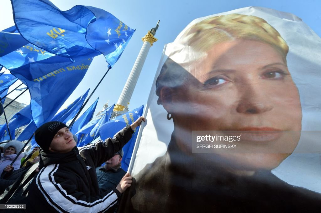 A man holds a flag bearing a picture of jailed former Prime minister Yulia Tymoshenko during a rally called by Ukrainian opposition 'against political repression!' on Independence square in Kiev on February 25, 2012, on the day of the start of the 16th Ukraine-European Union summit in Brussels.