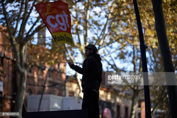 A man holds a flag of the CGT trade union More than 4000 protesters took to the streets of Toulouse against the new Macron's reforms on the Work Code...