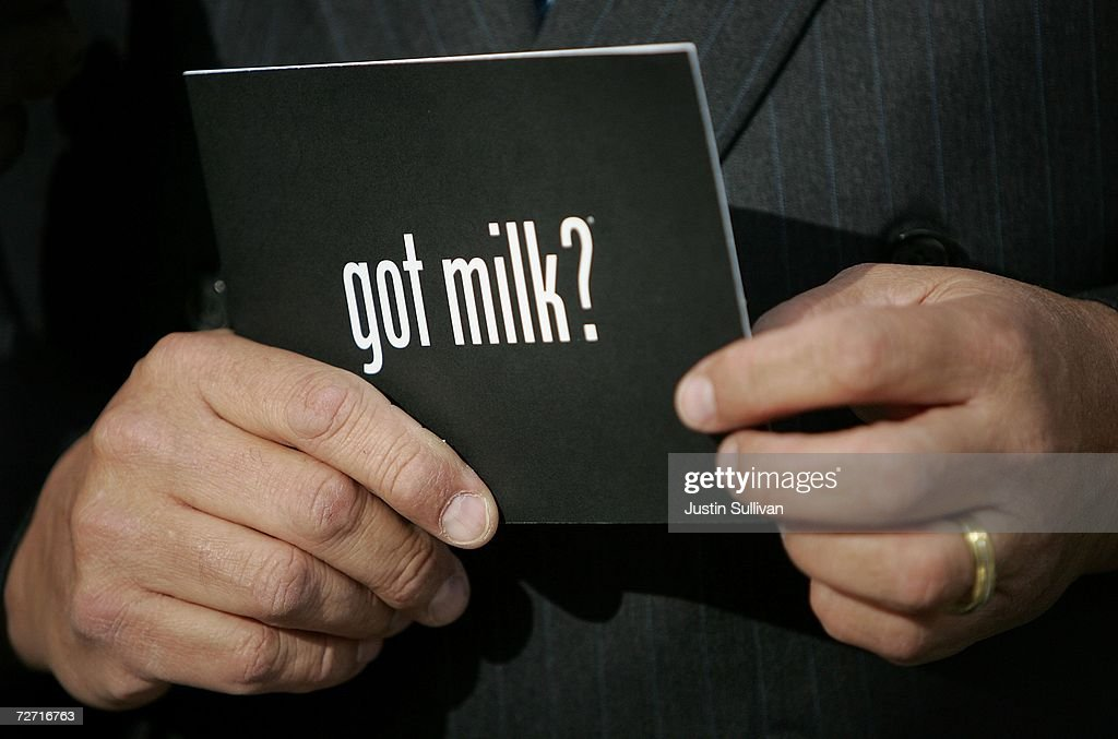 A man holds a Got Milk postcard while attending a news conference for cookie scented advertisements for milk at a bus shelter December 4 2006 in San...