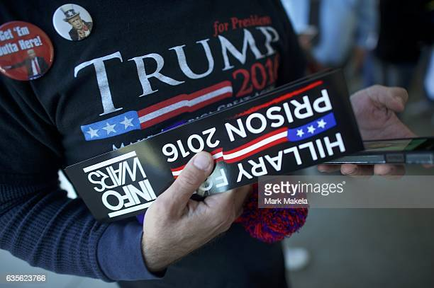 A man holds a 'Hillary for Prison 2016' sticker outside Giant Center before a rally for Republican Presidential nominee Donald J Trump November 4...