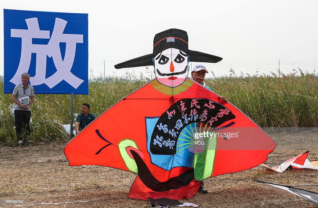 A man holds a kite on the 16th ChinaRudong International Kites Festival at Yangkou tourism resort on September 20 2015 in Nantong Jiangsu Province of...