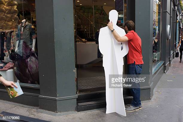 A TV man holds a lifesize cardboard cutout of Prince William in a London street during the filming of a vox pop In the weeks before the royal wedding...
