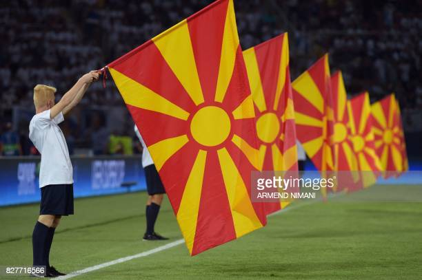 A man holds a Macedonian flag prior to the UEFA Super Cup football match between Real Madrid and Manchester United on August 8 at the Philip II Arena...