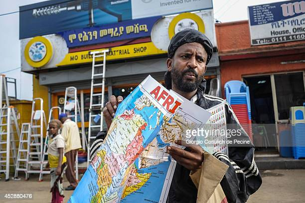 A man holds a map of Africa on July 01 2014 in Addis Ababa Ethiopia The Ethiopian government has recently launched a new urban plan for the...