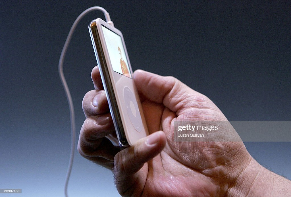 A man holds a new iPod with video capabilities October 12, 2005 in San Jose, California. Apple CEO Steve Jobs announced a new iPod that plays video, a new iMac and new version of iTunes that allows people to purchase videos and television shows.