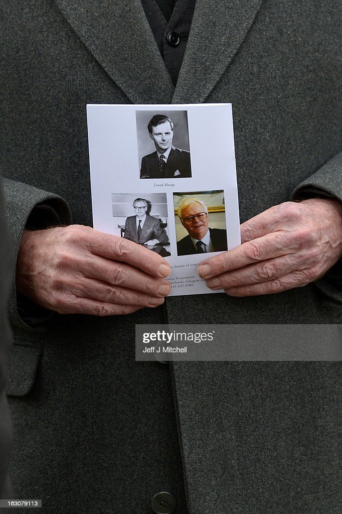 A man holds a order of service at the memorial service of former Scottish Secretary and European Commissioner Bruce Millan at Govan Parish Church on March 4, 2013 in Glasgow, Scotland. Bruce Millan died last Thursday aged 85 he had recently been diagnosed with cancer.