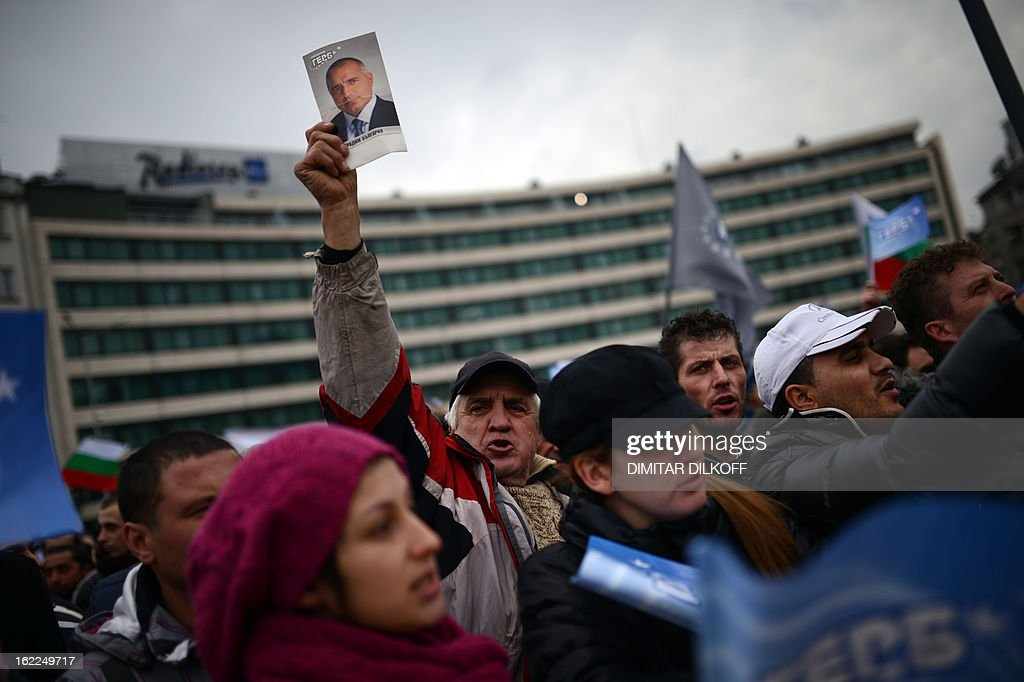 A man holds a picture of outgoing Bulgarian Prime Minister Boyko Borisov during a rally in support of him in front of the Parliament building in Sofia on February 21, 2013. Bulgaria's parliament accepted Thursday the resignation of Prime Minister Boyko Borisov's government after days of sometimes violent protests against high electricity bills and low incomes in the EU's poorest country. AFP PHOTO / DIMITAR DILKOFF