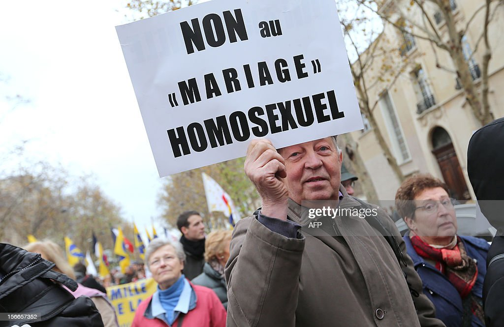 A man holds a placard during a protest organized by fundamentalist Christians group Civitas Institute against the same-sex marriage on November 18, 2012 in Paris. France's Socialist government on November 7, 2012 adopted a draft law to authorise gay marriage and adoption despite fierce opposition from the Roman Catholic Church and the right-wing opposition.
