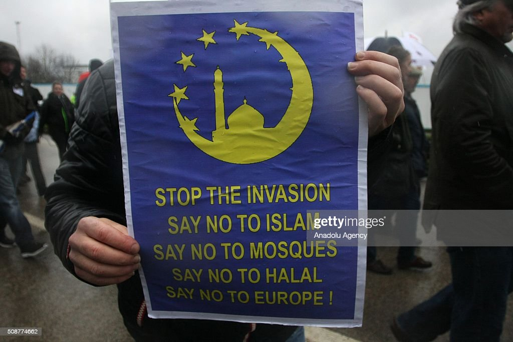 A man holds a placard during the 'silent march' organized by Pegida (Patriotic Europeans against the Islamisation of the West) UK supporters in Birmingham, England on February 6, 2016.