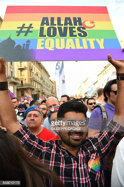 A man holds a placard reading 'Allah loves equality' during the annual Lesbian Gay Bisexual and Transgender Pride Parade in Milan on June 25 2016 /...