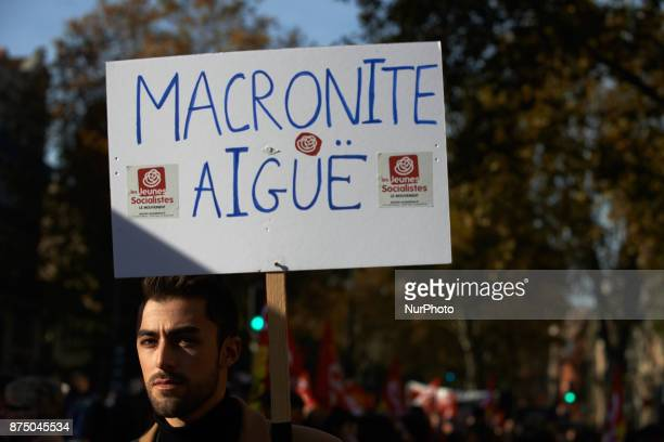 A man holds a placard reading quotAcute Macronite' More than 4000 protesters took to the streets of Toulouse against the new Macron's reforms on the...