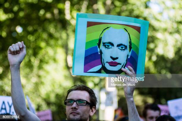 A man holds a placard showing President of Russia Vladimir Putin during the demonstration of the WorldPride 2017