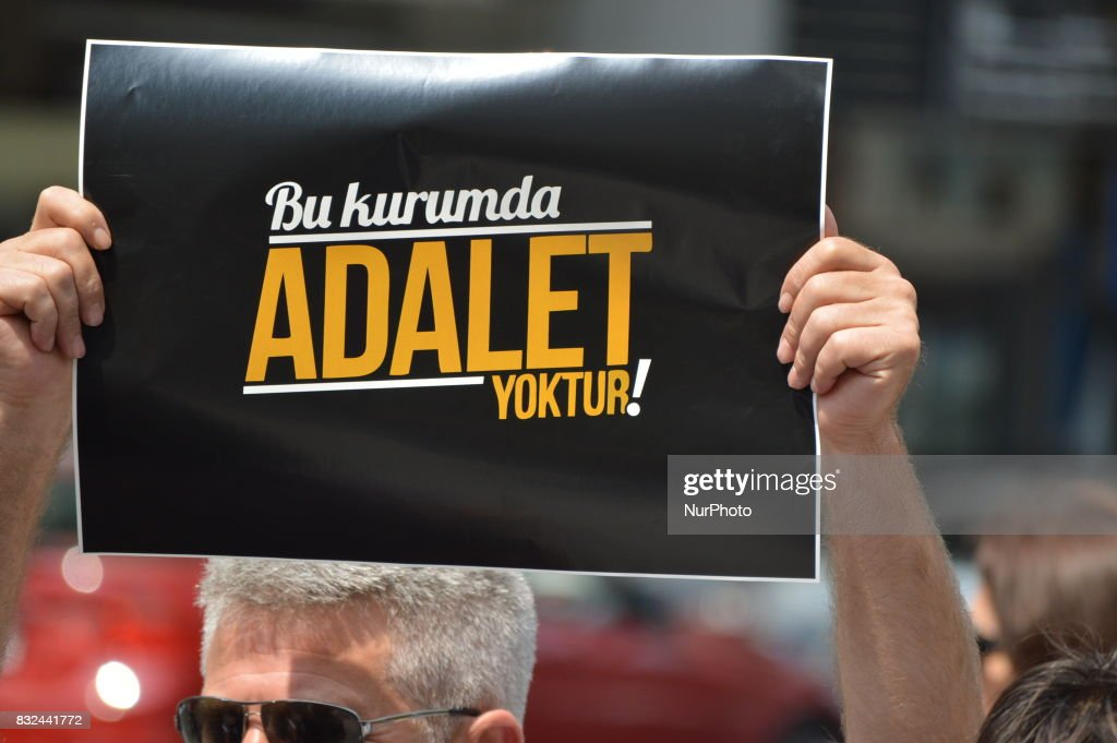 A man holds a placard that reads 'There is no justice in this council' as anti-government demonstrators gathered in front of the Supreme Election Council (YSK) to protest against unsealed ballot papers in the voting for the Turkish constitutional referendum in Ankara, Turkey on August 16, 2017. The referendum was held on April 16 as the demonstrators chant the slogan 'We still search for justice' in the fourth month after historic voting.