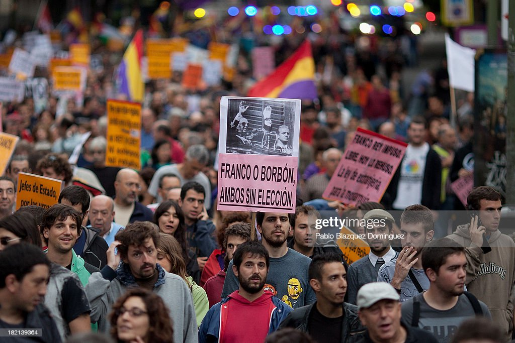 A man holds a placard that shows a picture of Dictator Francisco Franco and King Juan Carlos of Spain' during a demonstration against the Spanish Monarchy under the header 'Check the King' at Princesa Street on September 28, 2013 in Madrid, Spain. Organizers call for a demonstration on the anniversary of 'Surround the congress protest' to claim the abolition of the Monarchy. Currently King Juan Carlos of Spain is in hospital recovering from a hip operation. The Spanish Royal Family has lost popularity since the King injured his hip on elephant hunting trip and the King's son-in-law, Inaki Urdangarin is being investigated over a corruption scandal.