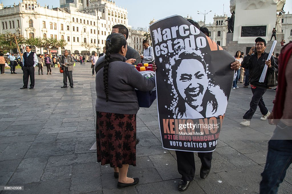 A man holds a placard with a message againts Keiko Fujimori during a march on the streets of Lima's downtown to protest against Presidential Candidate Keiko Fujimori on May 31, 2016 in Lima, Peru. Fujimori will be competing for Peru's Presidency on the second round of the electoral voting next June 5th.