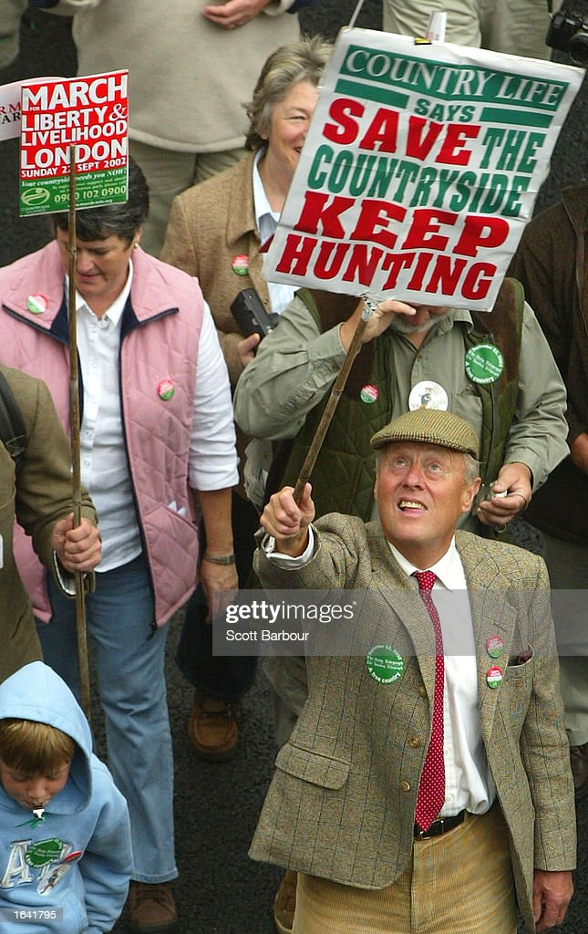 A man holds a pro-hunting sign as he marches with people through central London to highlight the needs of rural communities during the Countryside Alliance Liberty & Livelihood March September 22, 2002 in London, England. Protesters are demanding the right to continue fox hunting and are also pressing for action to help the economy of country areas, highlighting issues such as rural unemployment, poverty and crime.