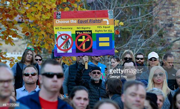 A man holds a protest sign in City Creek Park after many submitted their resignations from the Church of Jesus Christ of LatterDay Saints in response...