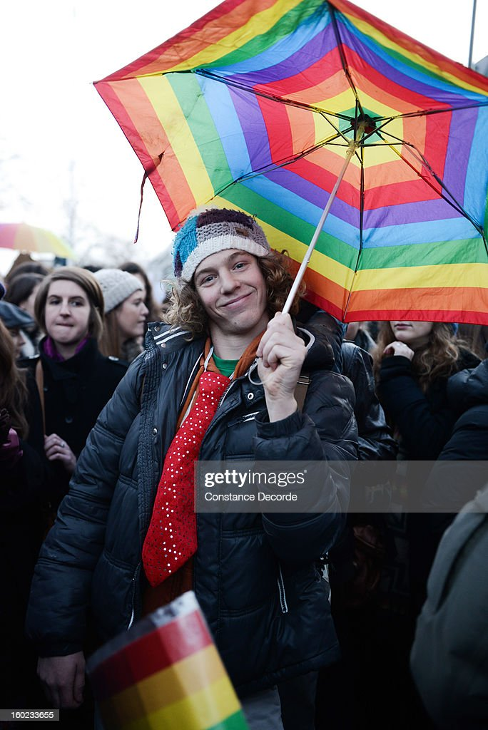 A man holds a rainbow umbrella during the marriage for all demonstration on January 28, 2013 in Paris, France. The marriage equality bill, which will be debated at the French National Parliament, would not only legalize same-sex marriage and also allow gay couples to adopt, a controversial issue in the bill. French President Francois Hollande supports the legislation but faces criticism from anti-gay and religious groups, while gay rights groups have concerns of inadequacies within the bill.