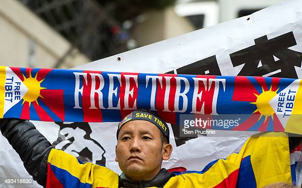 A man holds a scarf with the slogan 'Free Tibet' on as supporters of Amnesty International protest against claims of a deterioration in human rights...