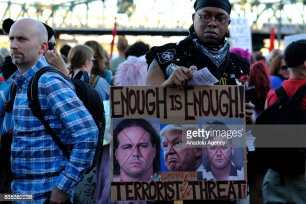 A man holds a sign against terrorism in Portland Ore United States on August 18 during a show of solidarity against hate with Charlottesville Va one...