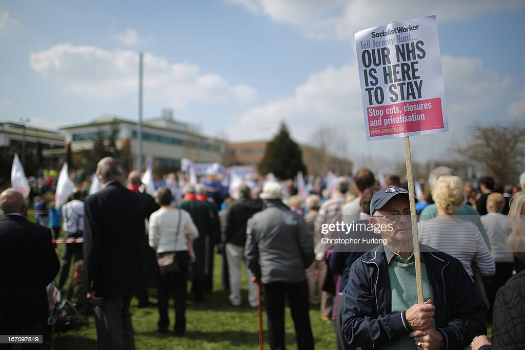 A man holds a sign as NHS staff and campaigners rally outside Stafford Hospital as they demonstrate to keep major health services at the scandal hit Stafford Hospital on April 20, 2013 in Stafford, England. The march was organised by the Support Stafford Hospital campaign group who are fighting cuts to major health services at the hospital. The Health regulator monitor has appointed two special administrators to produce a plan for the reorganisation of future services.