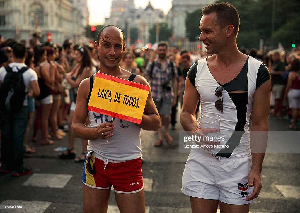A man holds a sign depicting the Spanish flag calling for non-religious education during the Madrid Gay Pride Parade 2013 on July 6, 2013 in Madrid, Spain. According to a new Pew Research Center survey about homosexual acceptance around the world, Spain tops gay-friendly countries with an 88 percent acceptance rate.