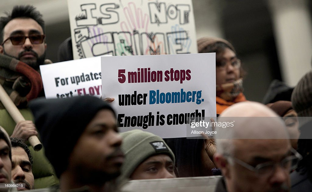 A man holds a sign during a demonstration against the city's 'stop and frisk' searches in lower Manhattan near Federal Court March 18, 2013 in New York City. Hearings in a federal lawsuit filed by four black men against the city police department's 'stop and frisk' searches starts today in Manhattan Federal Court.