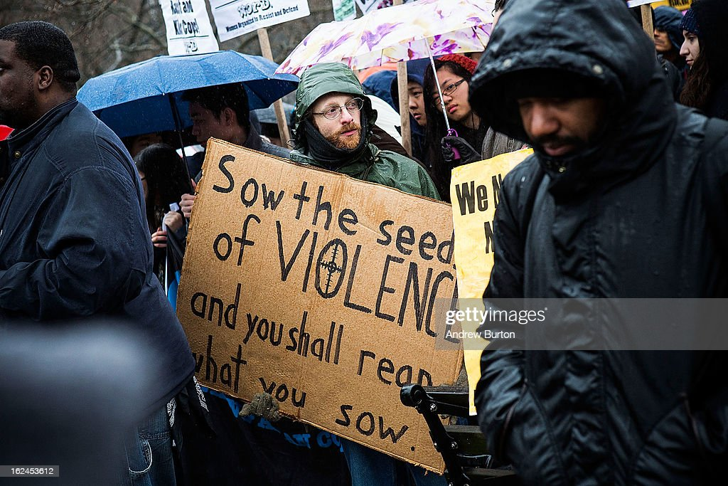 A man holds a sign during a march against police stop-and-frisk tactics on February 23, 2013 in New York City. The march, which consisted of a few hundred people, started in the Bronx borough of New York and marched into the Harlem neighborhood of Manhattan.