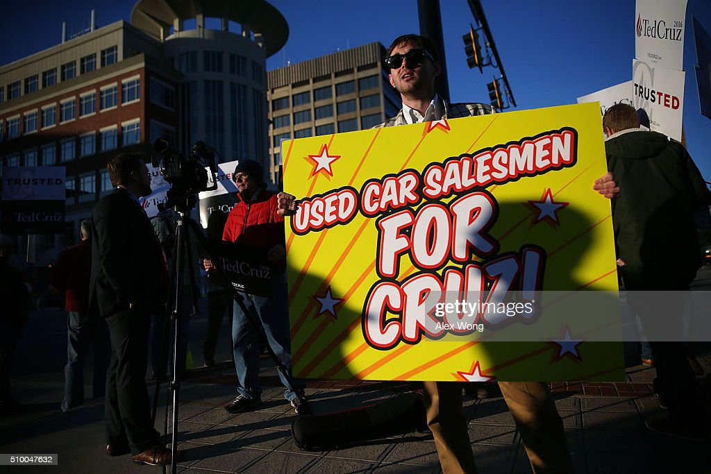A man holds a sign in front of supporters of Republican presidential candidate Sen. Ted Cruz (R-TX) prior to a CBS News GOP Debate February 13, 2016 outside the Peace Center in Greenville, South Carolina. Residents of South Carolina will vote for the Republican candidate at the primary on February 20.