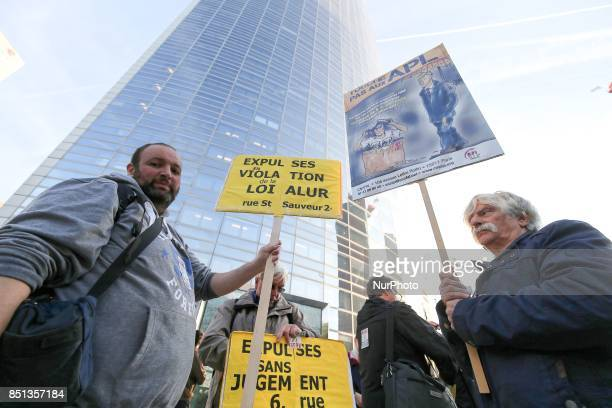 A man holds a sign reading Dont tuch to APLduring a demonstration against the reduction by 5 per month of the housing benefit in front of the...
