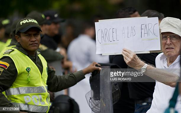 'Prison for FARC' during a march organized by citizens and relatives of victims remembering the soldiers killed in the internal conflict on April 25...