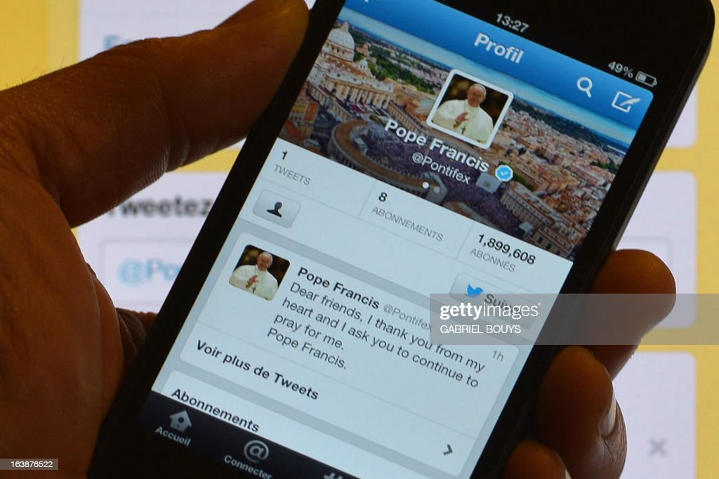 A man holds a smartphone showing Pope Francis' first tweet in front of a computer screen showing the same tweet on March 17, 2013 in Rome. Pope Francis issued his first tweet on Sunday shortly after performing his first Angelus prayer, with a consistent message: 'Pray for me'. 'Dear friends, I thank you from my heart and ask you to continue to pray for me,' the Argentine pope tweeted from the @Pontifex account.