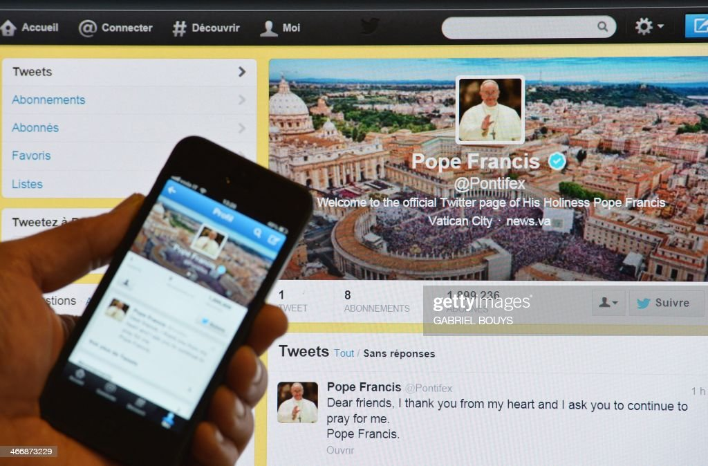 A man holds a smartphone showing Pope Francis' first tweet in front of a computer screen showing the same tweet on March 17, 2013, in Rome. Against all the odds, Pope Francis's Latin-language Twitter account is a roaring success, boasting 205,000 followers -- more than those following papal tweets in German or Arabic. Two months after former pontiff Benedict XVI joined the social networking site, enthusiasts of the ancient language persuaded him to open an account in Latin, without banking on it having much success, and the response stunned them. AFP PHOTO / GABRIEL BOUYS
