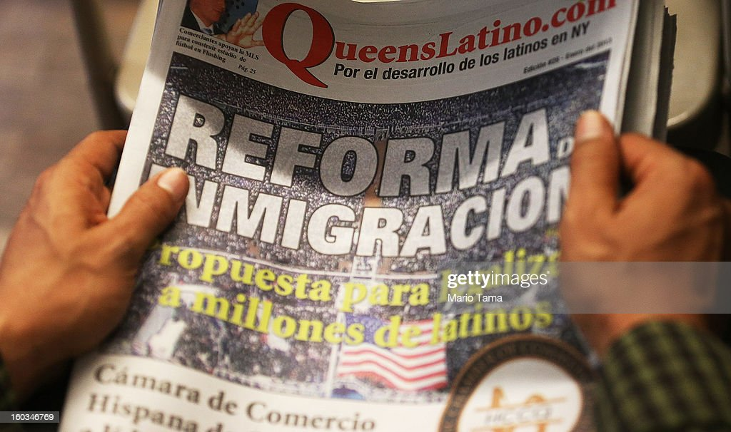 A man holds a Spanish language newspaper with an article on immigration reform during a watch party of President Barack Obama's speech on immigration on January 29, 2013 in the Queens borough of New York City. Obama called for immigration reform and a 'pathway to citizenship' for the nation's 11 million undocumented immigrants.
