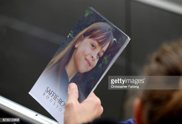 A man holds a thank you note from the family of Saffie Roussos to the those attending the funeral of the young Manchester Attack victim outside...