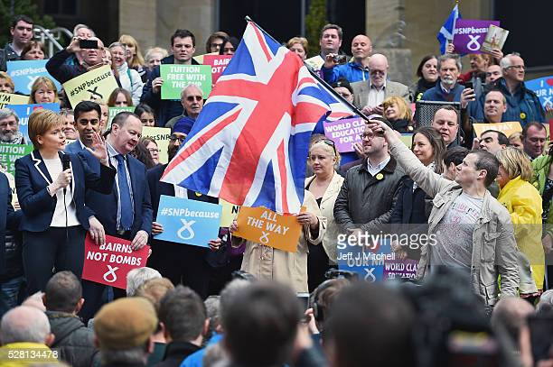 A man holds a Union Jack flag as the SNP leader and First Minister of Nicola Sturgeon holds her final party rally in Buchanan Street on May 4 2016 in...