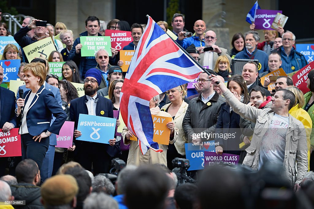 A man holds a Union Jack flag as the SNP leader and First Minister of <a gi-track='captionPersonalityLinkClicked' href=/galleries/search?phrase=Nicola+Sturgeon&family=editorial&specificpeople=2582617 ng-click='$event.stopPropagation()'>Nicola Sturgeon</a> holds her final party rally in Buchanan Street on May 4, 2016 in Glasgow, Scotland. Political party leaders will embark on the final day of campaigning in a bid to win over voters on the eve of the Scottish Parliament election.