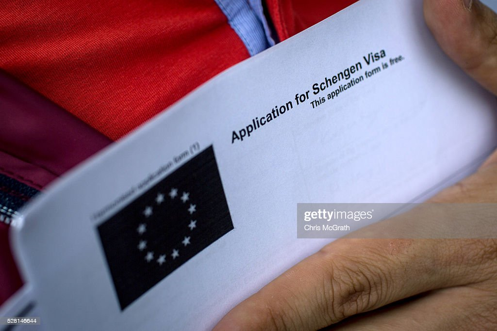 A man holds a Visa application form as he waits in line outside a Joint Visa Application center to apply for a Schengen visa on May 4, 2016 in Istanbul, Turkey. The European Commission today recommended Turkish citizens be granted visa free travel for short stay, business and tourist trips to Europe's Schengen area, as part of the EU-Turkey migrant deal. EU member states and the European Parliament are set to vote on the visa deal in June.